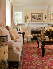 In the living room original stained glass windows light the timeless interiors that Ileana Indreland cultivated with Bozeman interior designer Helen Kent of Kent Interiors.