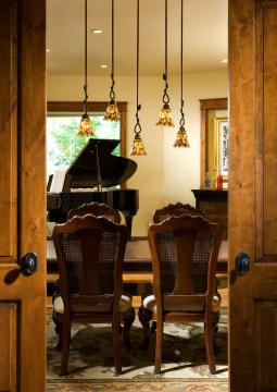 Artisan-made pendant lighting accents the formal dining room.