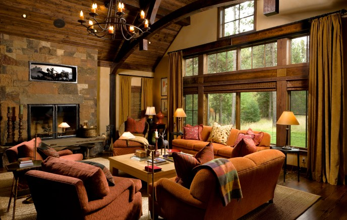 The great room serves as a gathering space for family, or a quiet retreat in the winter, warmed by both a palette of rich reds and ambers, and a Montana stone fireplace.