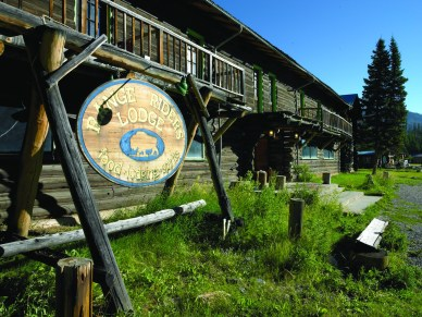 The rustic façade and sign of the massive log structured Range Rider Lodge, built in 1938.