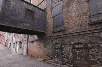 From the street, many of Butte's historic buildings have been covered with stucco, but in the alleys the architectural story is allowed to speak. Steel doors and an overpass in the alley near Club 13 hint at another era in Butte through different foundations, entrances and industrial necessity.