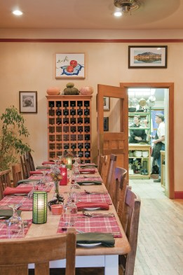 The dining room at The Old Hotel is warm, inviting and the kitchen is open to guests that want to look in on their favorite chefs.