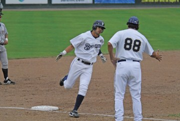 Helena Brewers player, Edgar Trejo rounds the bases. Below: Want to see the only live mascot living in its natural habitat in pro baseball? Then you need to spend a summer's evening at Missoula's Ogren Park, Allegiance Field. Photo by Kent Barnes