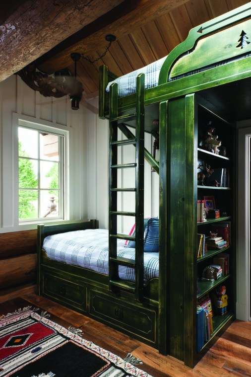 The home sleeps 18 comfortably when extended family or friends visit. Modeled after Norwegian farm bunks painted in deep red, blue or green, and found throughout the home, bunk beds built by Big Timberworks include built-in cabinets and drawers for space-saving functionality. The children's bunk room incorporates details such as railroad spikes and horseshoes for door and drawer handles, blending Norwegian design with the western vernacular.