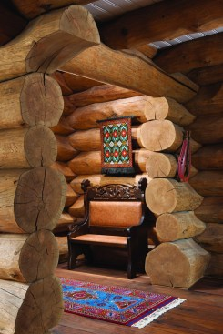 """The log walls are Douglas fir mostly harvested from private property in the Bridger Mountains for fire mitigation. """"I've been doing this for so long — selectively cutting logs — that … now I'm starting to see the younger trees coming of age to be house logs,"""" Blair Anderson said."""