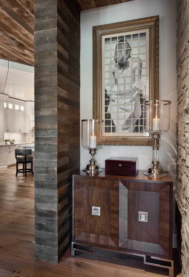 Reclaimed wood and stone in the living area set a precedent throughout the house.