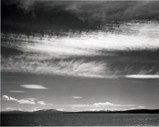 Lake, narrow strip of mountains, low horizon.