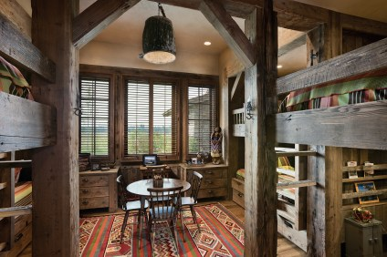"""In the bunkroom Schlauch Bottcher Construction built a customized kid zone, replete with beds fit for slumber parties of eight kiddos, a craft table and what the interior designer calls a """"palette like a crayon-box."""""""