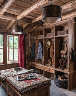 The light-filled mudroom with its oversized upholstered ottoman offers ample storage for summer and winter sports gear.