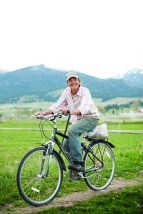 Lucy Breiger rides her bike home from the fields after a day of planting onions. Lucy, along with her husband Steve Elliot, own Lifeline Farm Produce in Victor, Mont. They are members of the Western Montana Growers Cooperative.