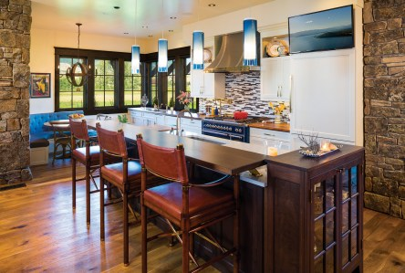 The fixtures, tile work and white cabinetry in the kitchen lend a contemporary feel.