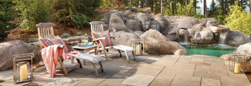 A granite sundeck leads to a one-of-a-kind hot pool designed by White Cloud Design.