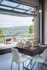 An intimate dining area flows seamlessly to an outdoor patio.