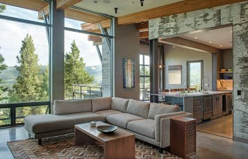 The open concept kitchen, dining, and living area offers beautiful views as the backdrop for gatherings.