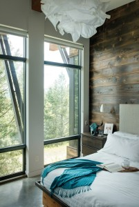The dark interior siding provides a striking contrast to the clean, contemporary palette of other interior elements.