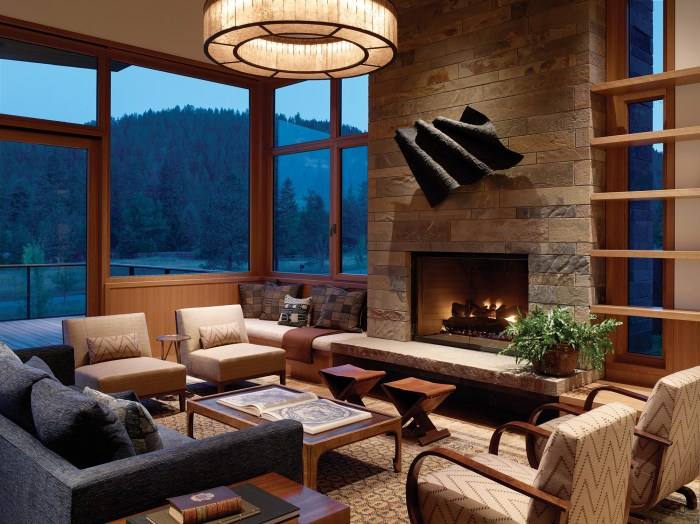 The vast windows of the living room afford 180-degree views up and down the narrow valley