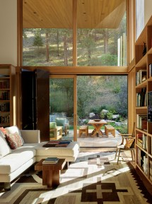 A secluded library provides a peaceful sanctuary and a view into the ponderosa forest beyond.