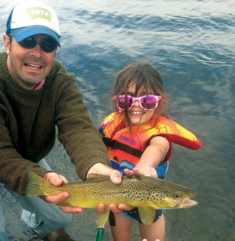 Author Chris Dombrowski with his daughter, Molly, and a nice brown trout.