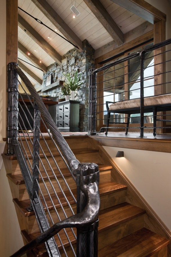 Designed by blacksmith Ira Cuehlo, the stairway is made with reclaimed chairlift cables.