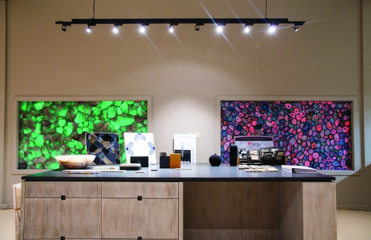 In the Earth Elements showroom, semiprecious slabs are backlit for a unique wall feature. Any color of light can be used.