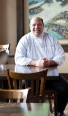 "Chef Warren Bibbins ""Bibber"" sits in the dining room at his restaurant Olive B's in Big Sky"