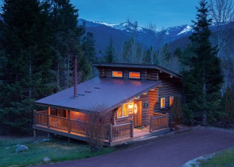 Big Sky is one of Triple Creek's one-bedroom luxury cabins nestled in the forested setting. It boasts a king bed, wood-burning fireplace and a private hot tub. Photo courtesy Triple Creek Ranch