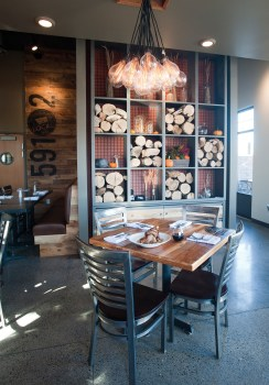 The space was designed by Brian Johnson of Collaborative Design Architects, and local artisans were used for the woodwork, steel welding, and other signature touches.