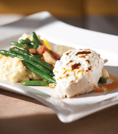 Baked Alaskan halibut with garlic mashed potatoes and roasted vegetables
