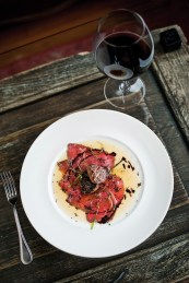 An appetizer of Montana wagyu beef carpaccio and seared foie gras with tomato oil and shaved black truffle reflects the Rainbow Ranch Lodge's approach to ranch-to-table cuisine.