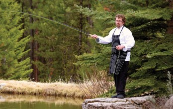 Chef Jake takes a break from teaching a cooking class to make a few graceful casts in the Triple Creek trout pond. Photography courtesy Triple Creek Ranch