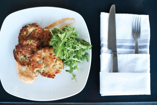 Crab cakes with garden arugula in citrus vinaigrette with spicy remoulade.
