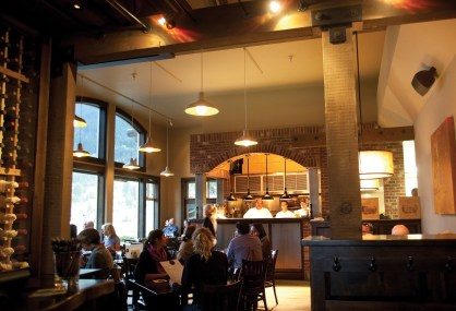 Olive B's Bistro's modern interior features an open kitchen and was designed by local architect Greg Dennee of Locati Architects.