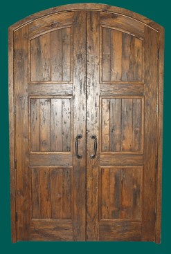 Recycled antique White Oak doors with scrub planed distress and a stain and glaze finish. Photo courtesy of Richard Garwood