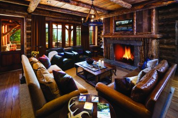 Another comfortable living room doubles as a TV room, away from the action.