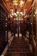The walk-in wine cellar has a copper ceiling and wine racks designed by Donn Fuller.