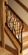 Gilmore evokes the patinas of nature with this stair railing.