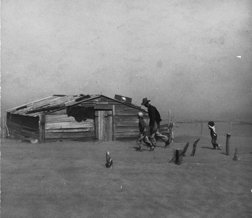 Father and sons walking in the face of a dust storm. Cimarron County, Oklahoma   Photo courtesy of Library of Congress