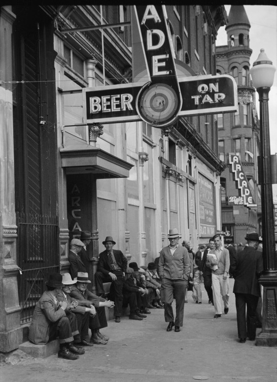 Men Lounging in Front of Arcade, Butte, 1939 | Photo courtesy of Library of Congress