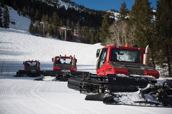 Shortly after the slopes close for the day, the grooming team heads uphill and gets ready for the night's work.