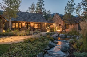 A small stream adds an element of tranquility to the property.