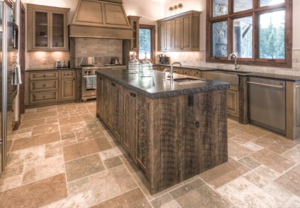 Kitchen flooring options are numerous, from wood to tile and stone, and comfort is key. Photo courtesy Erika & Company