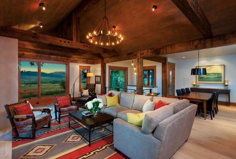 """A lofted ceiling lends an open feel to the great room even while complementing the exterior views. The interiors were designed to be comfortable and contemporary. """"What [interior designer Laura Fedro] does so well are the textures, combining the different fabrics and finishes,"""" said homeowner Diana Rudolph."""