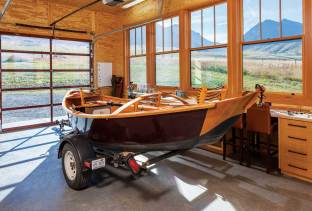 Half of the rod barn hosts the homeowners' drift boat. The barn was designed as a shell so that Siem could organize the space to meet his needs.