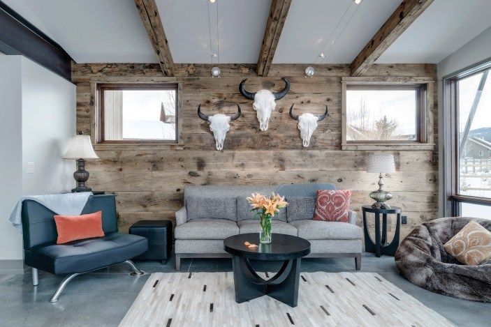 Interior siding, made from the reclaimed wood of a former bridge over the Gallatin River, is accented with buffalo skulls.