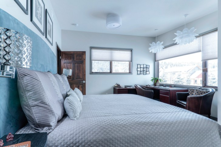 A vision in blue, the bedroom features petal lights assembled by the homeowner.