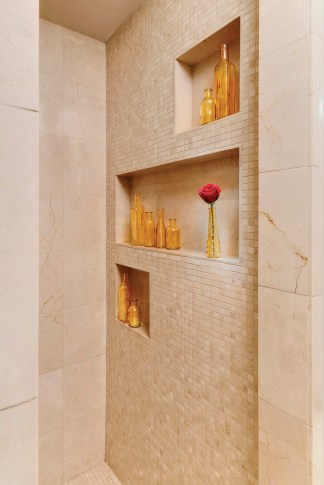 Recessed nooks in the shower offer built-in convenience.