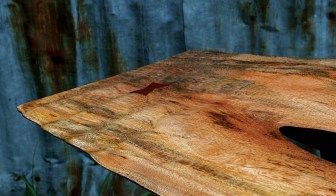 """Carney carved a ripple into the end of the live-edge slab of """"The Yellowstone"""" hall table to evoke the water surface of the Yellowstone River."""