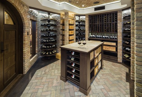 A wine cellar built for the owner's collection is finished with bricks reclaimed from the old train depot in Dillon, Montana. They infuse warmth and lend the character of age to the space.