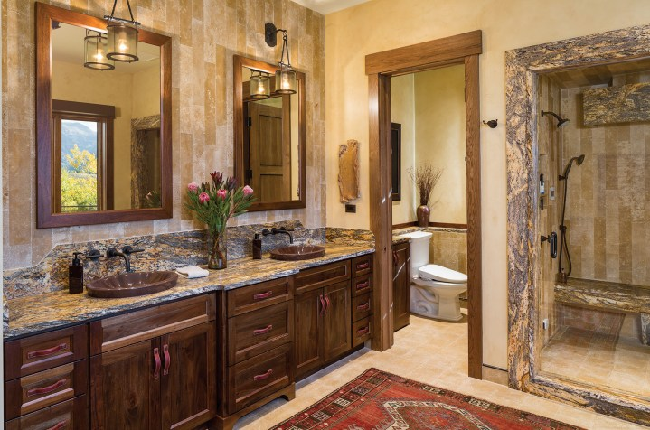 Stonework throughout the house was sourced through Montana Tile & Stone for a consistently clean and refined aesthetic.