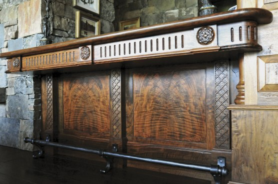 Book matched Claro Walnut bar with hand carvings and clearcoat with glaze finish. Photo courtesy of Richard Garwood